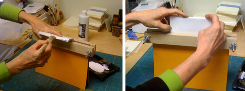 Fanning the spine for glue and then bringing the text block upright to squeeze and consolidate
